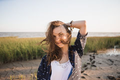 Woman 30-40 years dressed in boho style. Holding herself by the head royalty free stock image