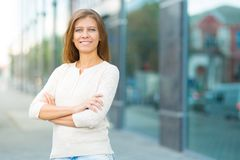 Woman 30 years old walking in the city on a sunny day stock photography