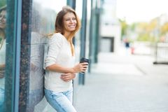 Woman 30 years old walking in the city on a sunny day royalty free stock image