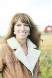 Woman 60 years old wheat portrait countryside. Happy adult woman outside coffee Royalty Free Stock Photography