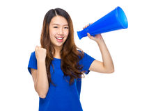 Woman yell with megaphone. With isolated white background Royalty Free Stock Photo