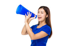Woman yell with megaphone. Isolated on white background Stock Image
