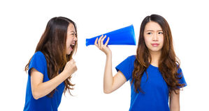Woman yell to other with megaphone Stock Photography