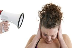 Woman yelled at by a megaphone Stock Photo