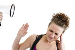 Woman yelled at by a megaphone Royalty Free Stock Photos