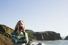 Woman Yelling On Cliff royalty free stock photography