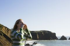 Woman Yelling On Cliffside Royalty Free Stock Images