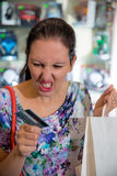 Woman yelling at her credit card Stock Photography