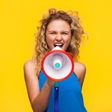 Woman yelling with loudspeaker stock photo