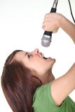 Woman yelling into microphone Stock Photography