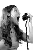 Woman yelling on the phone Stock Images