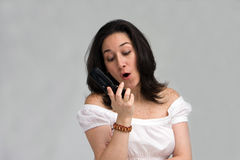 Woman yelling on phone royalty free stock photo
