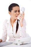 Woman yelling on somebody over telephone Royalty Free Stock Image