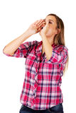 Woman yelling using her hands as megaphone Stock Photo