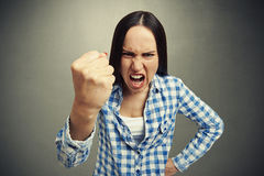 Woman yelling and waving her fist Stock Images