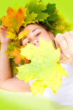 Woman with yellow autumn leaves Stock Image