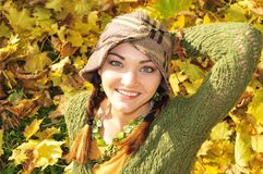 Woman in yellow autumn leaves Royalty Free Stock Photo