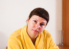 Woman in yellow bathrobe. Women in yellow bathrobe at home stock images