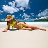 Woman in yellow bikini lying on beach at Seychelles Royalty Free Stock Images