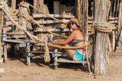 Woman in yellow bikini lying on tropical beach at Seychelles.  Stock Photos