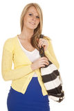 Woman in yellow and blue hold purse smile Royalty Free Stock Photo