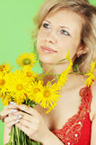 Woman and yellow bouquet Royalty Free Stock Photography
