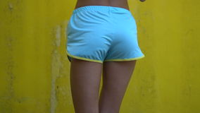 Woman in yellow bra and blue sporty shorts stock video