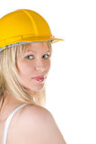 Woman in yellow building helmet Stock Image