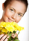 woman with yellow chrysanthemums Stock Photos