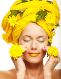 Woman with yellow chrysanthemums Royalty Free Stock Photos