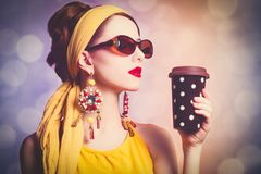 Woman in yellow clothes with coffee. Style redhead woman in yellow clothes with coffee. Photo with bokeh on background stock image
