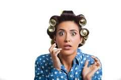 Woman with yellow curlers Stock Image