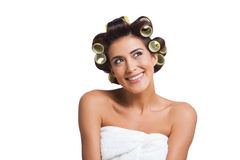 Woman with yellow curlers Royalty Free Stock Image