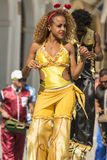Woman in yellow dancing on stilts Havana royalty free stock photos