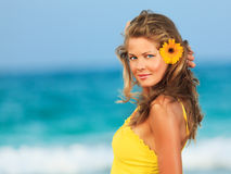 Woman in yellow dress Stock Images