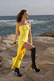 Woman in yellow dress on the beach Stock Image