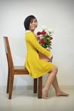 Woman in yellow dress with a bouquet of roses Royalty Free Stock Photography