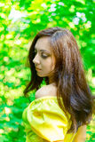 Woman in  yellow dress in the forest. The concept of expectat. A woman in a yellow dress in the forest Royalty Free Stock Photo