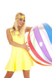Woman yellow dress headband beach ball smile Royalty Free Stock Photo