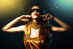 Woman in yellow dress and mask Royalty Free Stock Image