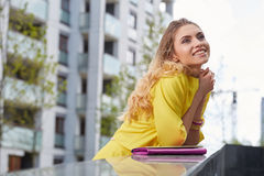 Woman in yellow dress posing outdoors Royalty Free Stock Photo