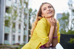 Woman in yellow dress posing outdoors Royalty Free Stock Photos