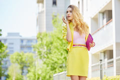 Woman in yellow dress posing outdoors Stock Photography