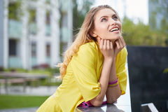 Woman in yellow dress posing outdoors Stock Photos