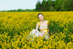 Woman on yellow field Royalty Free Stock Images