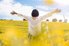 Woman in yellow field Stock Photography