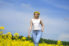 Woman  in a yellow field wreath Royalty Free Stock Photography