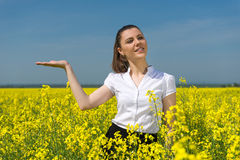 Woman in yellow flower Stock Image
