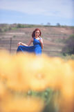Woman in yellow flower field Stock Photography