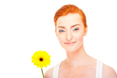 Woman with yellow flower near her face Stock Photography